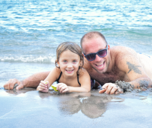 A father and daughter enjoy time on the beach